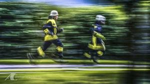 Fotodesign Feuerwehrleute im Einsatz Langzeitbelichtung